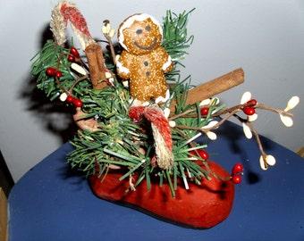 Santa boot with gingerbread arrangement