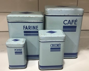 A set of 4 Vintage French Art Deco Tin Canisters