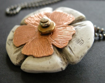 faux bone and copper flower necklace on  a sterling silver ball chain