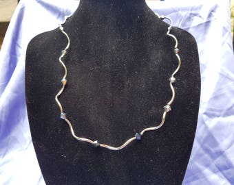 Glass crystal and silver necklace.