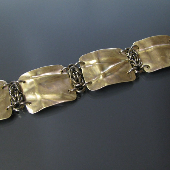 brass fold form bracelet with light brown anodized niobium Byzantine chainmaille weave