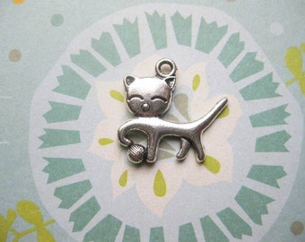 8 Cat Charms in silver tone - C2147