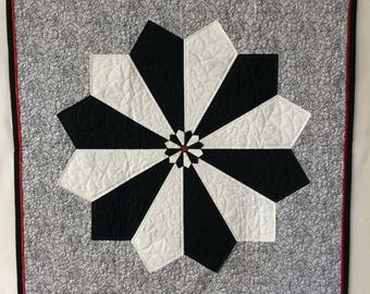 Bold black and white quilted wall art