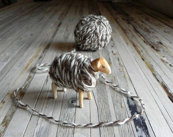 Unique wooden toy sheep dressed with handspun organic wool