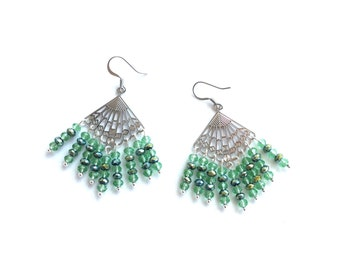 Laser cut chandelier fan earrings with irridescent green crystals