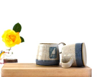 Handmade ceramic blue and white mug with upright dove image - handthrown stoneware pottery