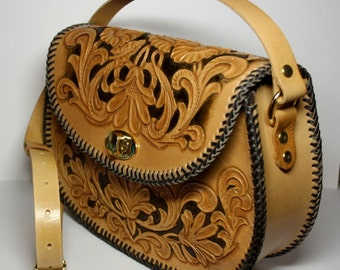 Handmade handtooled leather handbag with hand-carved floral pattern in Sheridan style