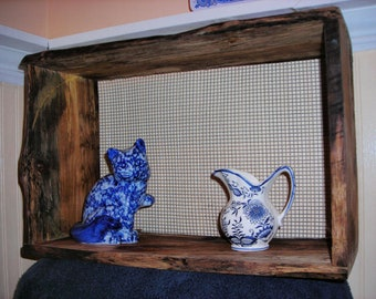 Display shelf made from recycled black walnut with wire grid back for a beautiful unusual display shelf.