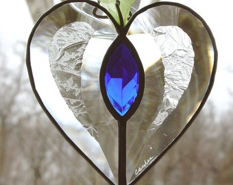 Charming heart, etched clear glass is the main part with blue faceted jewel in the center.