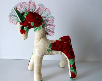 Romantic horse in beige, red and green floral fabric