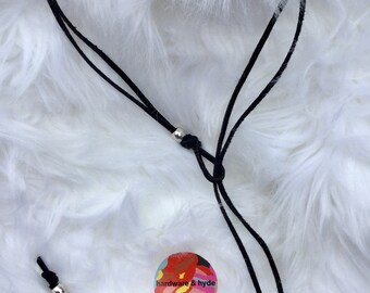 Black leather silver tone hardware lariat style necklace