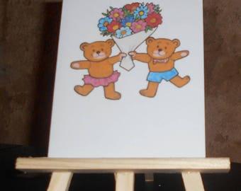 Carte 2 ours avec un bouquet de fleurs