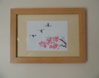 A watercolour print of geese in flight over tree in blossom, Framed print ready to hang.