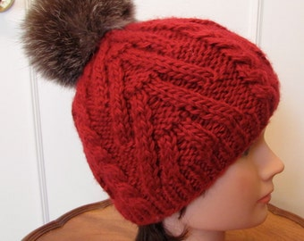 Knitted hat  with racoon fur pom pom