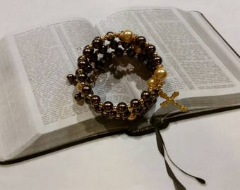 Five decade rosary bracelet, memory wire bracelet, wrap bracelet, brown and yellow glass pearls, gold toned crucifix, religious bracelet