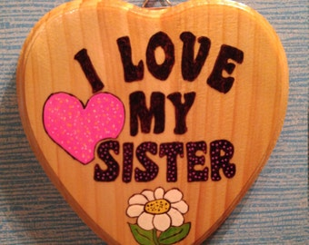 "Wood burned ""I love my Sister"" Wood Heart Plaque, Pink,   6.5 in.  20.00"
