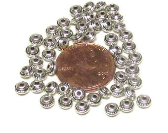 5x3mm Antique Silver Tibetan style spacers. Bicone shaped with 1.5mm hole. (100)