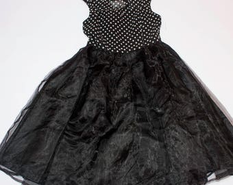 Sleeveless dress with polka dot bodice and wheeled skirt