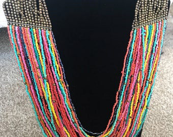 Stunning multi strand beaded necklace in multi coloured beaded strands. Beautiful unique necklace