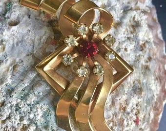 Vintage goldtone brooch/pendant with rhinestones