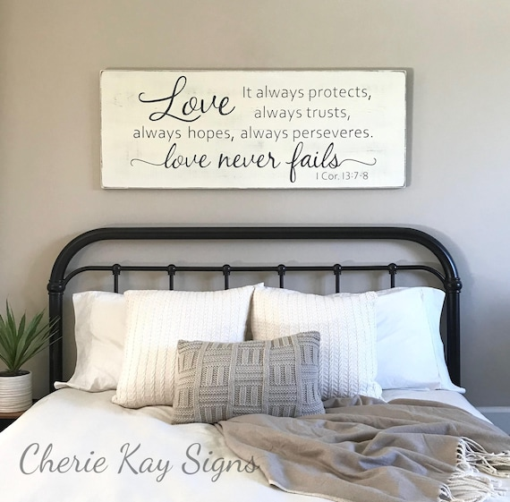 Master bedroom wall decor Love never fails 1 Corinthians