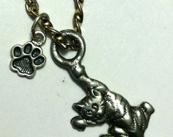 Cat charm necklace.