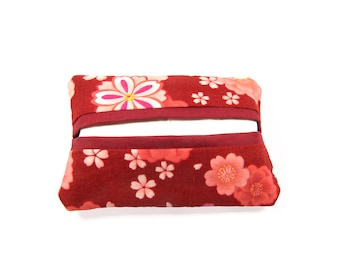 Handkerchief case with pink and white cherry blossoms on red background