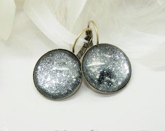 Glitter & silver Glitter stars earrings black