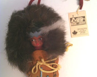 Vintage Cree Papoose in leather moccasin