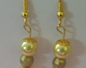 Yellow pearls and bronze disco ball