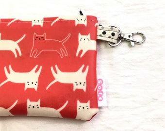 sofs offers a small laminated  fabric iphone pouch. In meow meow.