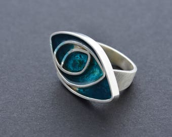 Bespoke sea blue resin and brushed silver statement ring. Dark teal colour. Modern style.