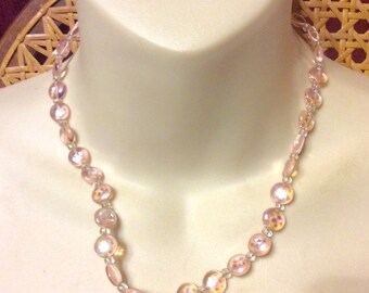 Pink lampwork glass aurora borealis finish beaded necklace.