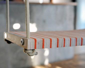 Flexible wooden-felt indoor swing