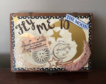 Altered box with retro moon face collage motif.  Vintage wooden cigar box altered for decorative storage.