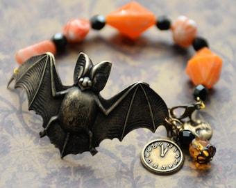 Bat Bracelet, Antiqued Brass Flying Vampire Bat Charm Bracelet, Orange and Black Handmade Bracelet, Orange Vintage Beads, Candy Corn Beads