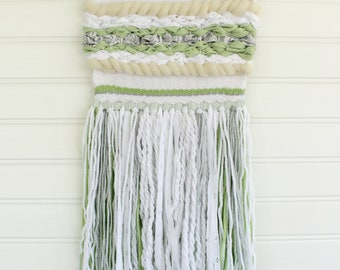 Green woven wall hanging