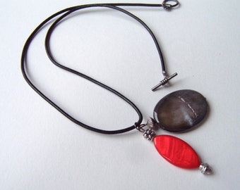Mother-of-pearl two part pendant necklace on a leather strap