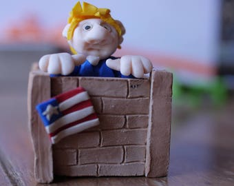 Donald Trump fimo behind his wall figurine