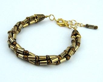 Hematite Torsade Bracelet, Antiqued Gold, Gold Plated Toggle Clasp, Chain, Handmade, Twisted Strands, Titanium Coated Hematite Tubes, Gift