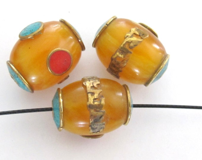 Tibetan copal resin Om mantra bead with brass , turquoise and coral inlay -  1 bead - BD375