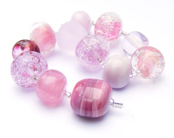 Handmade lampwork glass bead set of 12 mainly pink renegade lampwork orphans