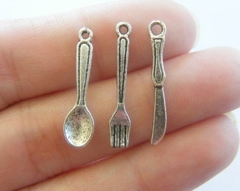The Cutlery Collection - 24  antique silver tone charms