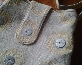 Beige circle fabric purse bag with applied silver discs