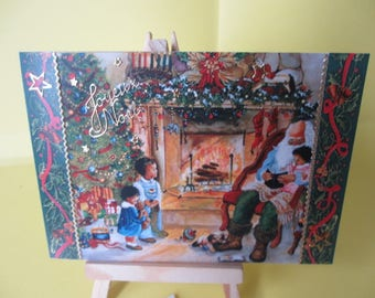 Merry Christmas card with Santa Claus with children in front of the fireplace and stickers gold