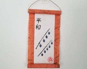 Peace in Japanese calligraphy on a small wall scroll with minimalist lantern flower art