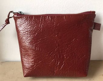 Red crinkle patent leather clutch