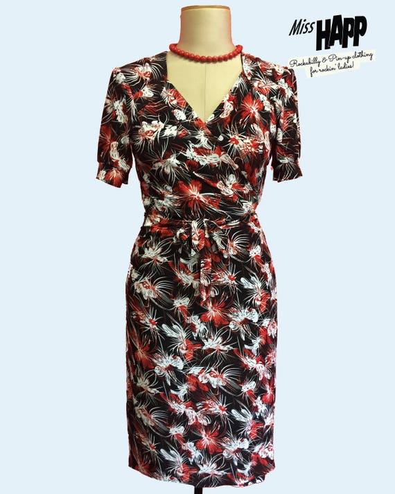 1940s Style Dresses | 40s Dress, Swing Dress Cassidy 1940s floral Tiki Wrap DressCassidy 1940s floral Tiki Wrap Dress $70.00 AT vintagedancer.com