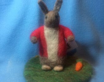 Needle felted wool bunny on felted wool grass