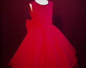 Girls red dress with a big bow at the back.